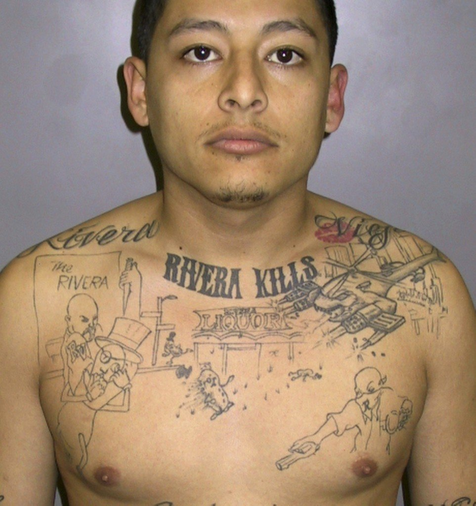 The Associated Press This undated photo provided by the Los Angeles Sheriff's Department shows convicted murderer Anthony Garcia, sentenced to 65 years in prison in 2011 after a homicide investigator discovered he had the scene of an unsolved 2004 murder inked on his chest.
