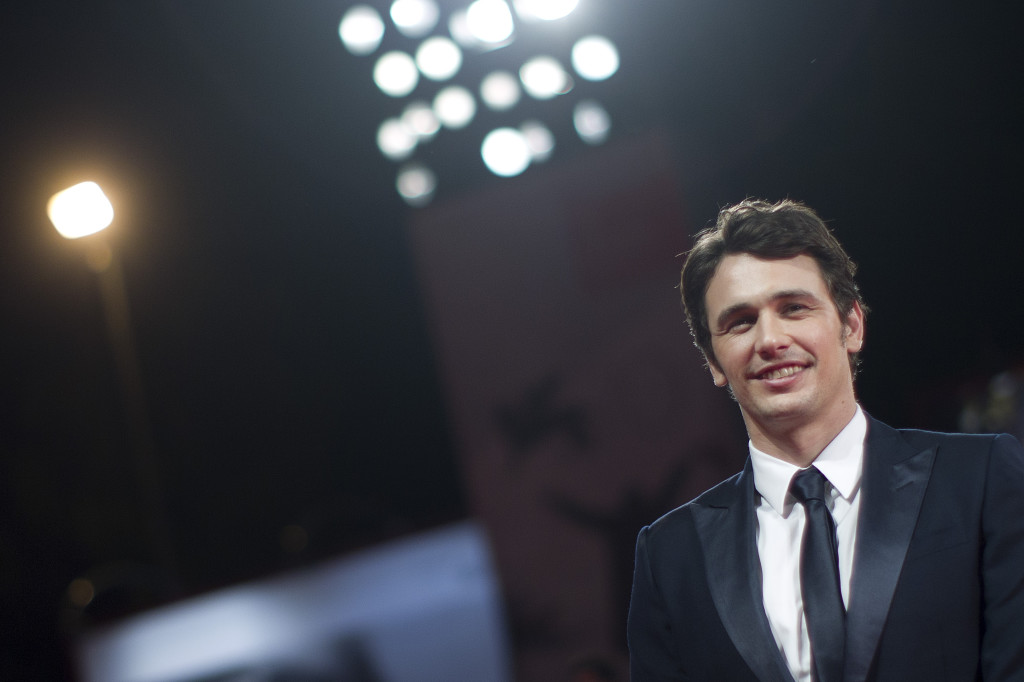 "James Franco poses for photographers on the red carpet for the screening of the film ""Child Of God"" at the  Venice Film Festival, in this Aug. 31, 2013, photo."