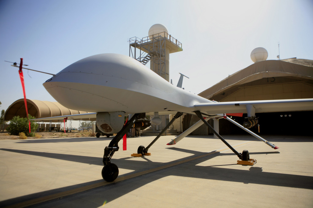 An MQ-4 Predator sits on the tarmac at Balad Air Base, north of Baghdad, Iraq, in this 2007 photo.  A Pentagon official says drones have started overflights to bolster manned and unmanned reconnaissance flights.  The Associated Press