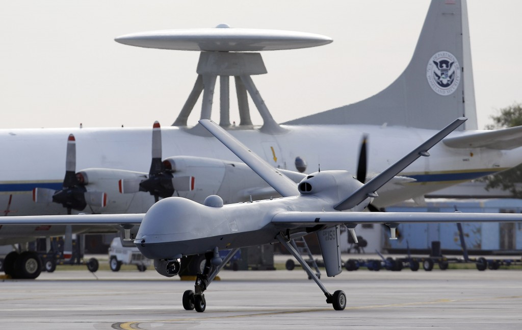 In this 2011photo, a Predator B unmanned aircraft taxis at the Naval Air Station in Corpus Christi, Texas. Missiles from U.S. drones slammed into militant hideouts overnight in northwestern Pakistan, killing more than a dozen  suspected insurgents