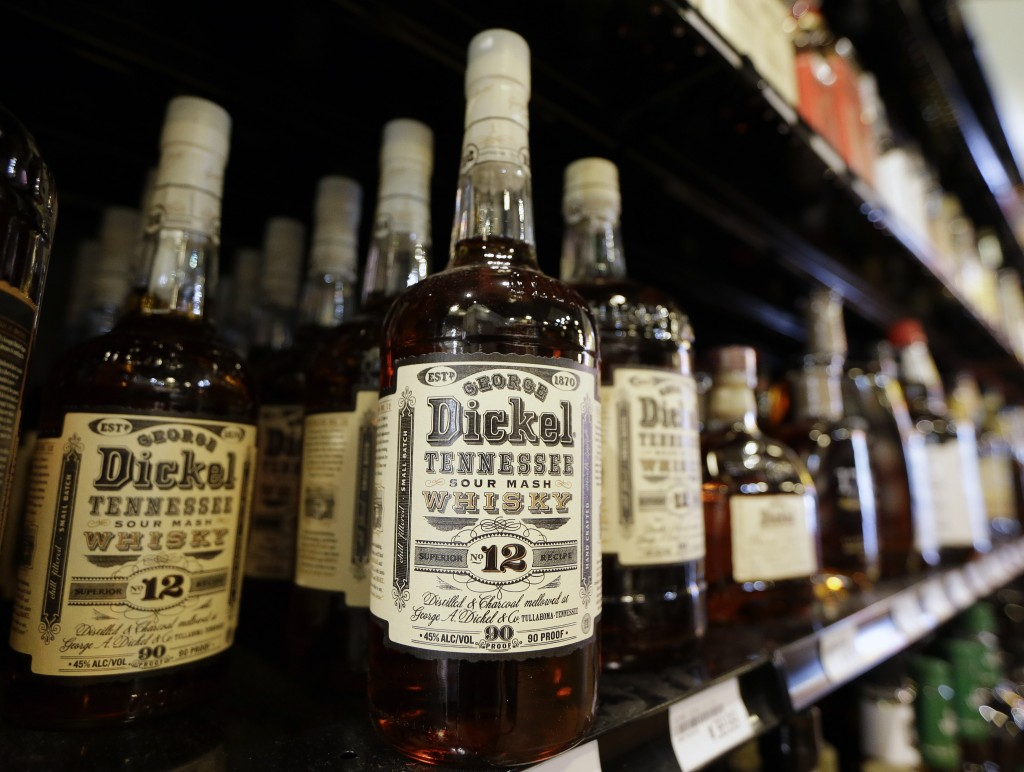 Bottles of George Dickel Tennessee whiskey are displayed in a liquor store in Nashville, Tenn. Alcohol regulators ended their investigation into whether George Dickel, a subsidiary of liquor giant Diageo, violated state laws by storing whiskey in neighboring Kentucky.  The Associated Press