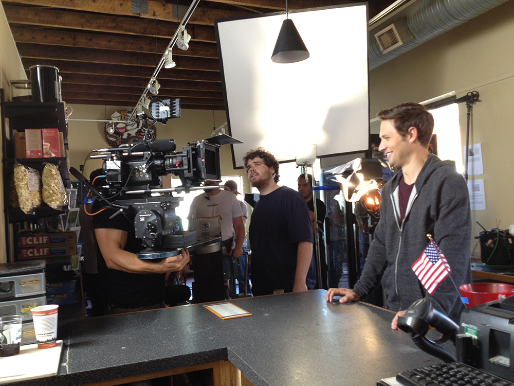 Actor Michael Cassidy, right, stands in place before a scene shot begins inside Coffee By Design. Amelia Kunhardt/Staff Photographer