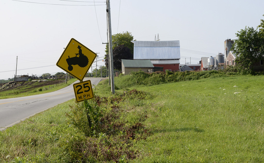 A sign warns drivers of tractor crossings near the Bisson farm in Topsham.