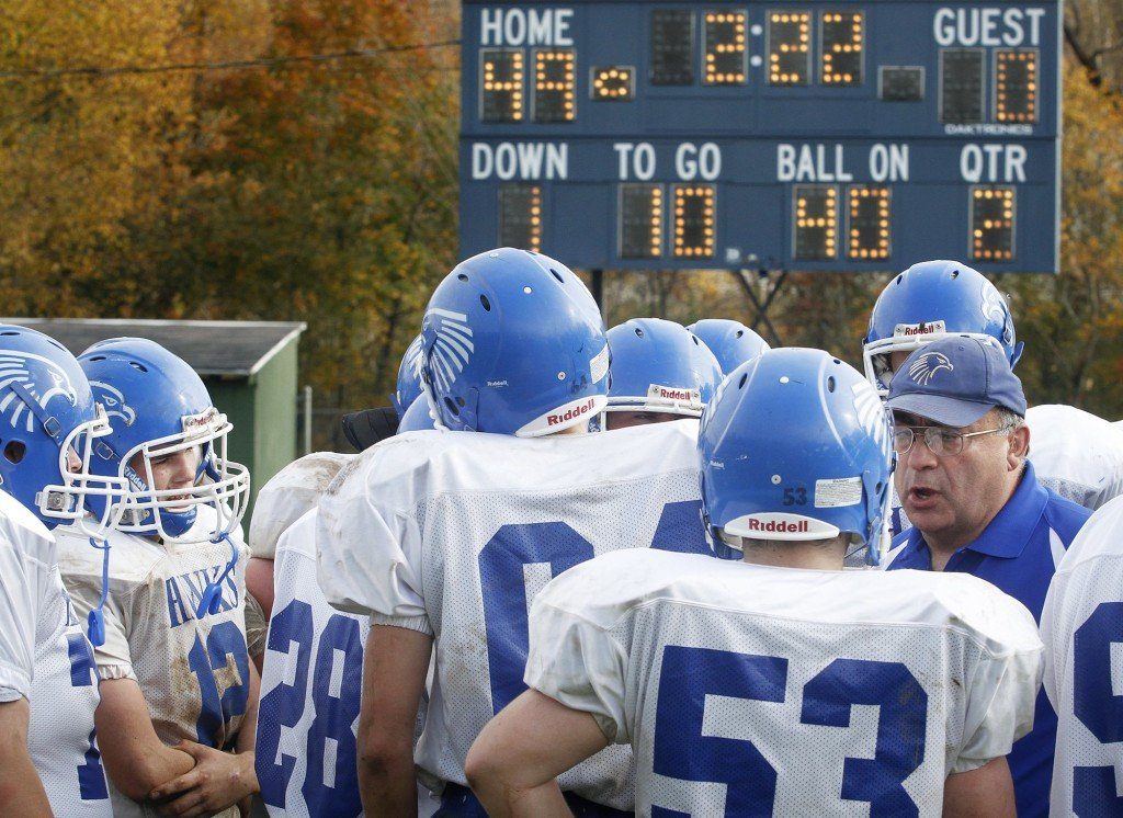 Sacopee Valley football coach Chuck Hamaty talks with his players during the 2012 season. Derek Davis/Staff Photographer