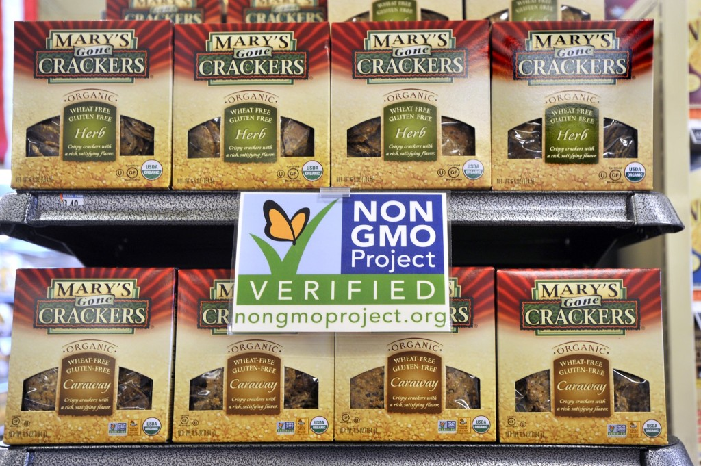 In this file photo from July 2013, Whole Foods marked their shelves with labels promoting non-GMO products.
