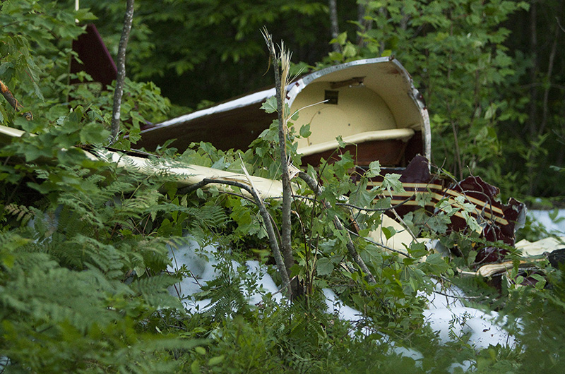 The wreckage of a 1942 Culver LFA single-engine plane sits in the woods where it crashed a few hundred yards from the Limington airport runway Saturday.  Clarke Tate, 52, of Gray was killed in the crash. Carl D. Walsh/Staff Photographer