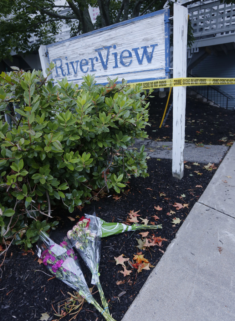 Bouquets of flowers were placed at 23 Water St. in Saco where Maine State Police were investigating the discovery of five bodies. Derek Davis/Staff Photographer