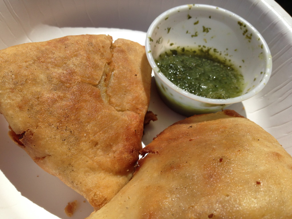 Vegan samosas with mint chutney.