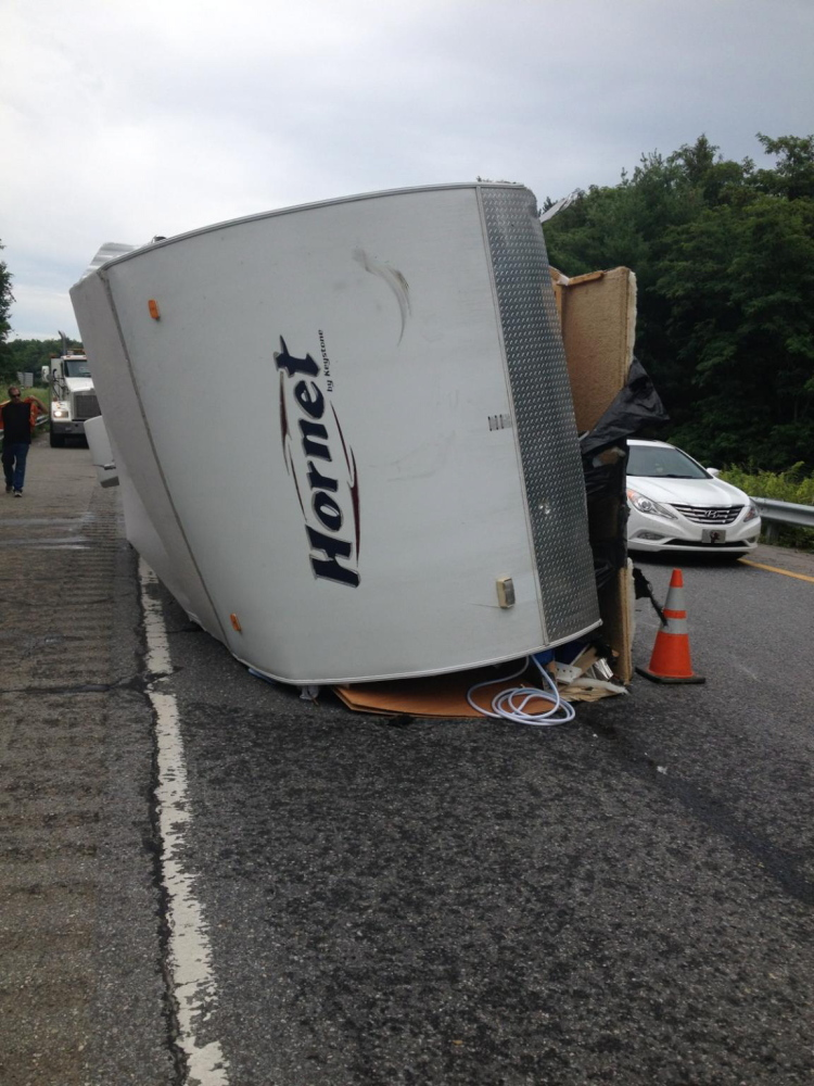 A truck and its trailer flipped on I-95 late Sunday morning, backing up southbound traffic for more than four hours. Photo courtesy of Maine State Police