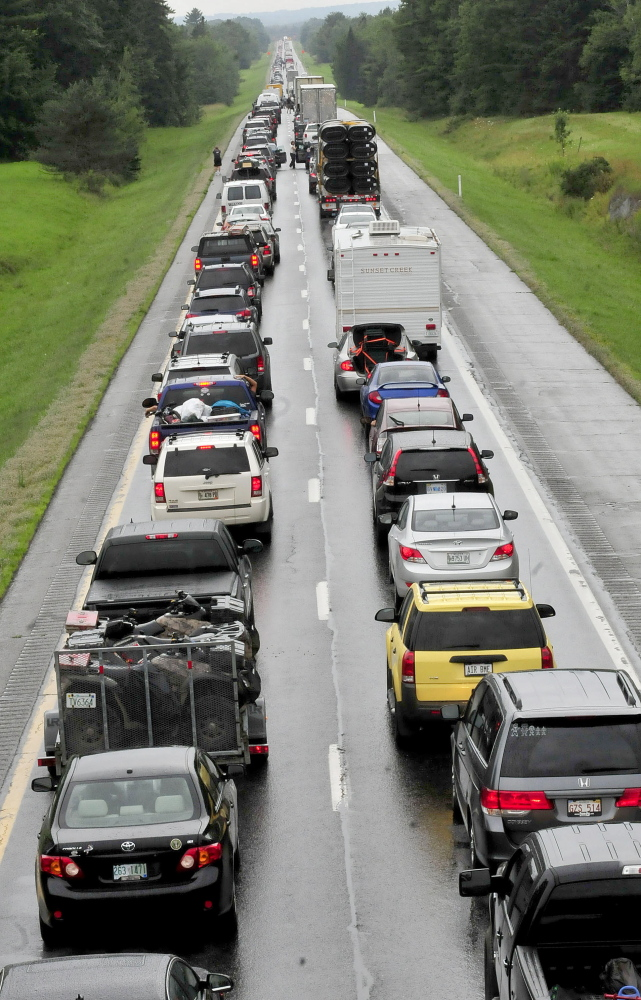 Southbound traffic on Interstate 95 was backed up for miles Sunday from mile 134 in Benton to the Clinton exit following a rollover involving a truck hauling a trailer. David Leaming/Morning Sentinel