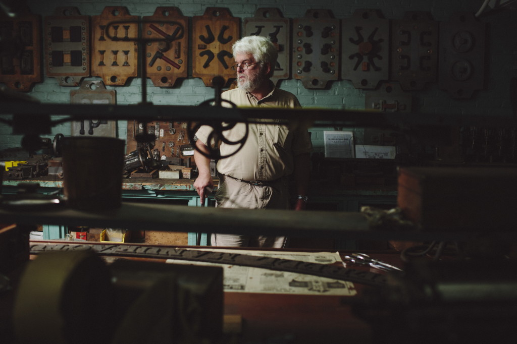 George Collord stands in his workspace in Building 36 of the Pepperell Mill Campus on Tuesday. Collord is an industrial historian, and has spearheaded efforts to save the Lincoln Mill clock tower, which will be relocated from the Pepperell Mill Campus in Biddeford on Thursday. Photo by Whitney Hayward / Staff Photographer