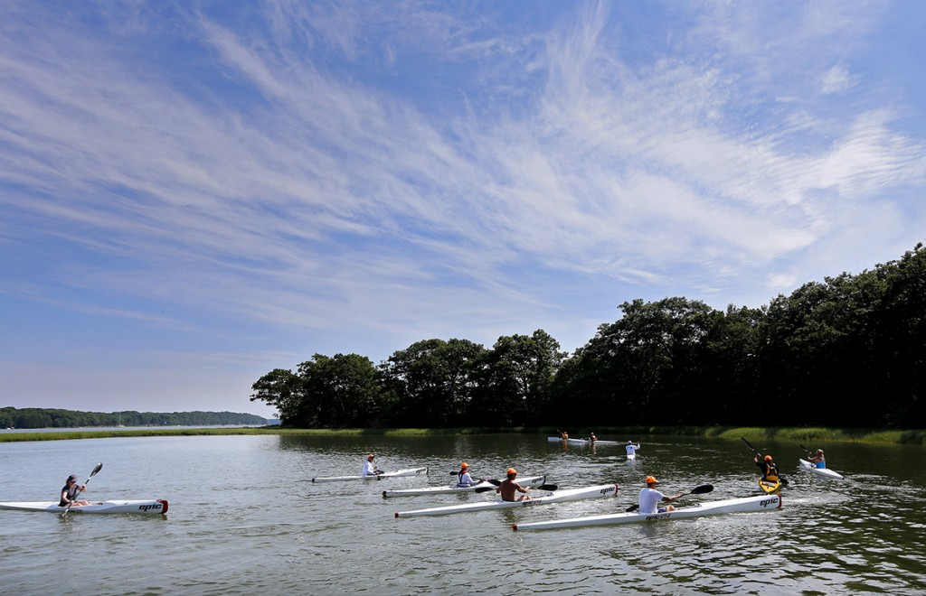 Paddling enthusiasts attend a surf ski kayak lesson at Thomas Point Beach.