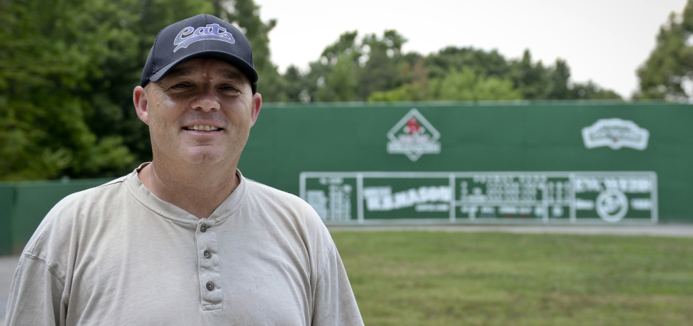 David Spainhour stands in his backyard in King, N.C., which he fashioned into a mini Fenway Park.