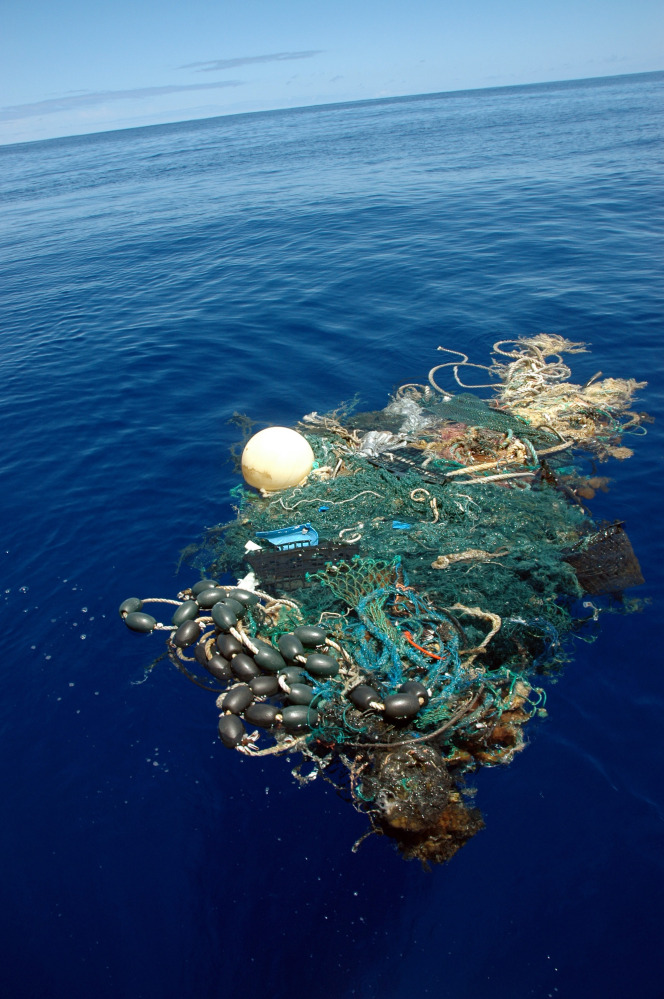 A patch of sea garbage, some of it plastic, floats in the Pacific Ocean in 2009. The research ship that recently circled the globe to measure the extent of such debris did not look at plastic sitting beneath the surface or on the ocean floor.