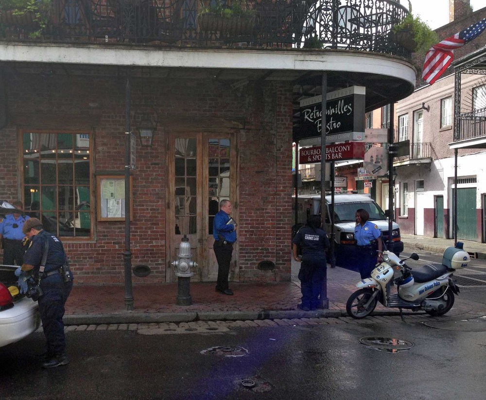 Authorities work the scene along Bourbon Street in New Orleans after a shooting early Sunday. Ten people were shot, with at least one person in critical condition.
