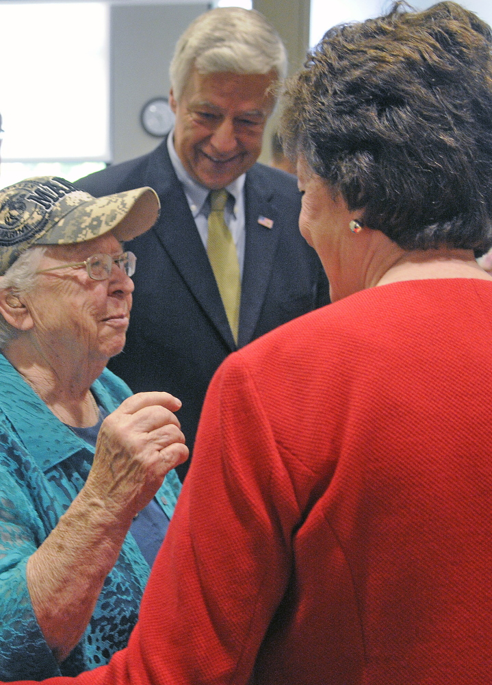 Marine Corps veteran Ruby Gilmore, 83, greets U.S. Rep. Mike Michaud and U.S. Sen. Susan Collins on Monday at the women's clinic during the grand opening.