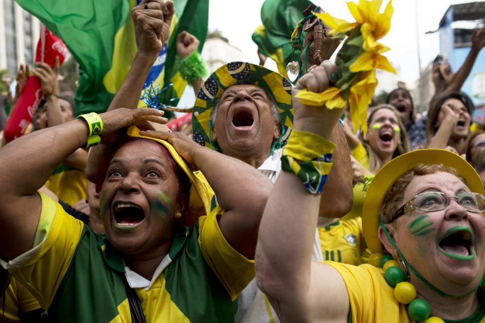 In this June 28, 2014 file photo, Brazil fans celebrate after their team scored a goal during a penalty shootout at the World Cup round of 16 soccer match between Brazil and Chile inside the FIFA Fan Fest in Sao Paulo, Brazil.