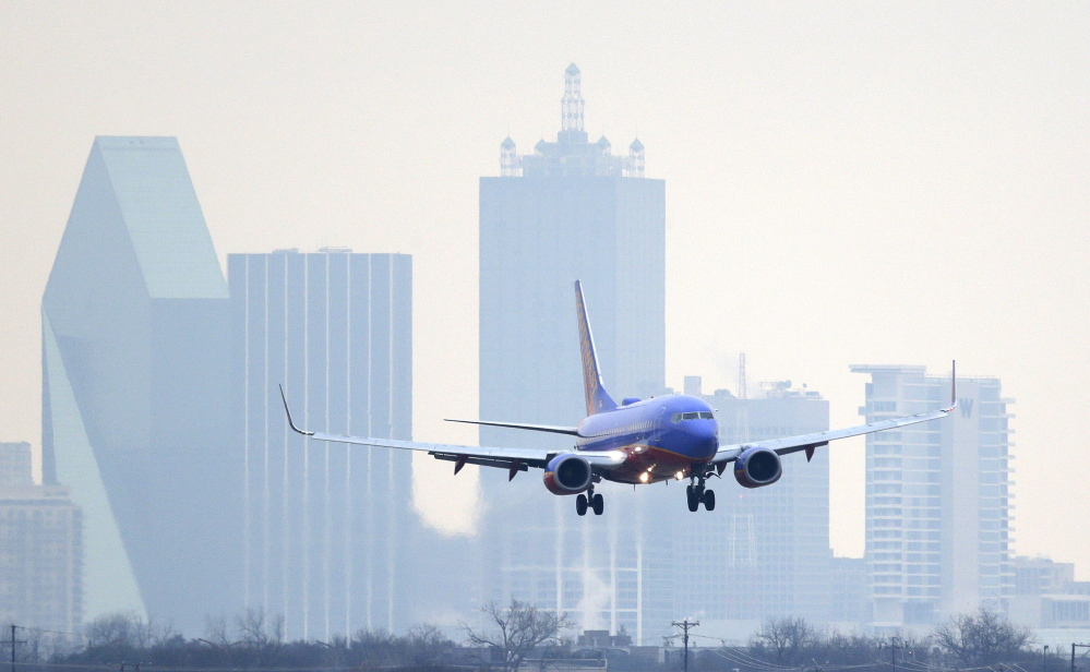 The Associated Press In this Feb. 3, 2014 file photo, a Southwest Airlines jet plane lines up for a landing at Love Field in Dallas.