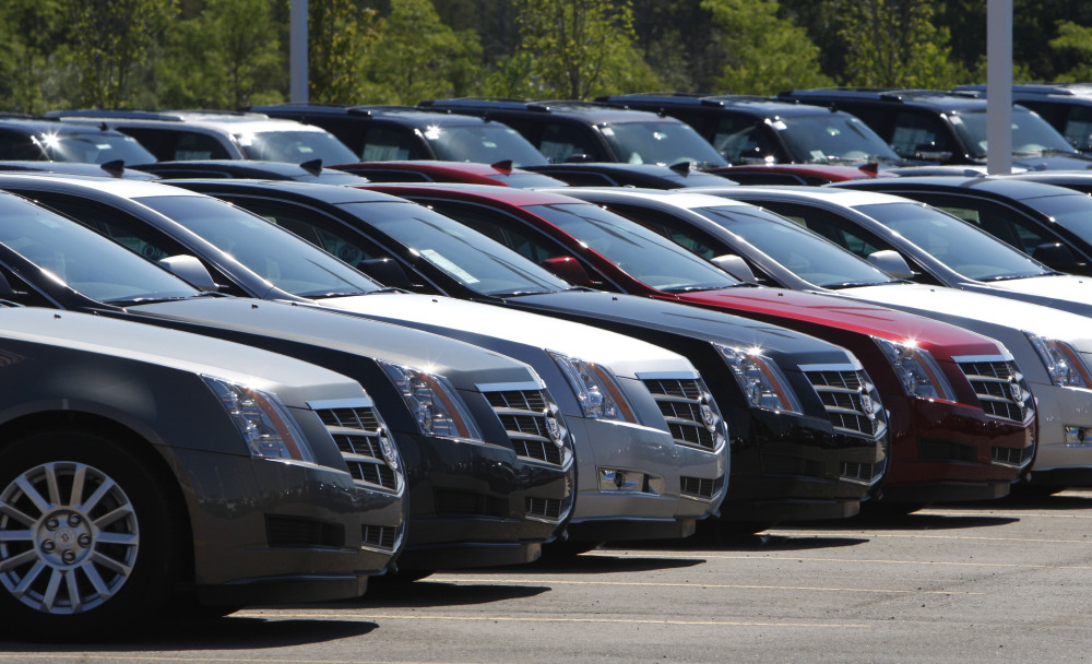 Cadillac CTS models, which are covered in one of GM's latest recalls, are displayed outside a Michigan dealership.