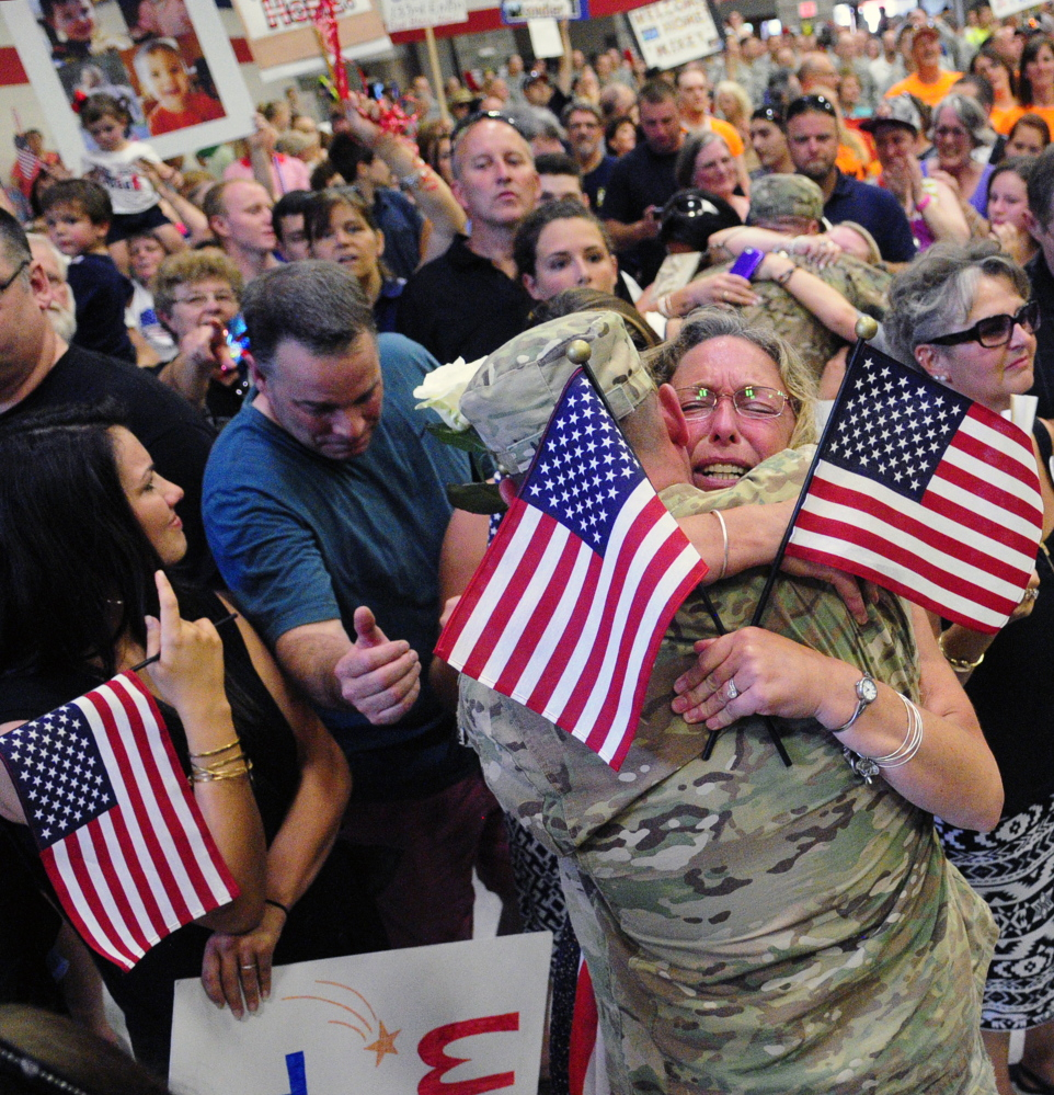 Hundreds of wives, husbands, parents, grandparents, children and others packed the sweltering Augusta Armory, breaking out in sustained applause as the soldiers filed in. When they were officially dismissed, there was a mad scramble, followed by hugs, kisses and tears.