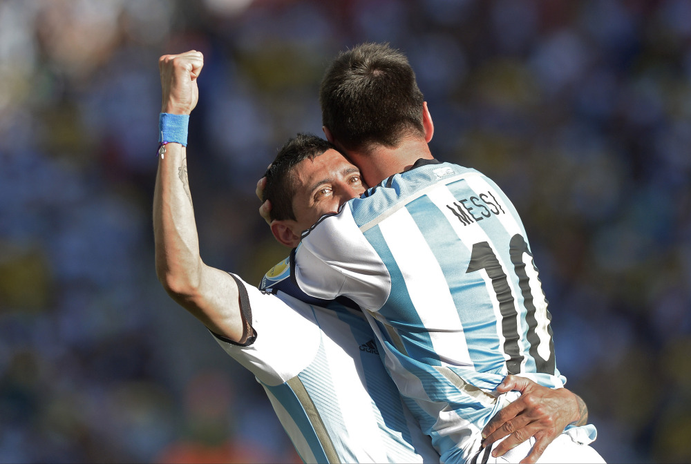 Argentina's Lionel Messi celebrates with Angel di Maria after di Maria scored his side's only and winning goal in extra time during the World Cup round of 16 soccer match between Argentina and Switzerland at the Itaquerao Stadium in Sao Paulo, Brazil, on Tuesday.