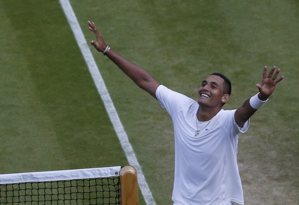 Nick Kyrgios of Australia celebrates defeating Rafael Nadal of Spain in their men's singles match on Centre Court.