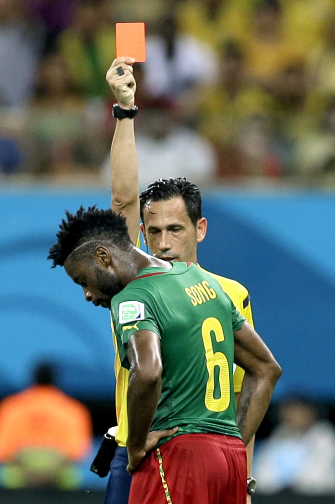 "In this Wednesday, June 18, 2014 file photo, referee Pedro Proenca from Portugal gives a red card to Cameroon's Alex Song during the group A World Cup soccer match between Cameroon and Croatia at the Arena da Amazonia in Manaus, Brazil. Cameroon's football federation said late Monday, June 30, 2014, it will investigate allegations of match-fixing by its team at the World Cup and the possible existence of ""seven bad apples"" in the squad."