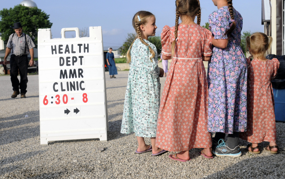 Mennonite girls gather at a clinic offering vaccinations against measles, mumps and rubella, in Shiloh, Ohio, last week. The religion of the Amish doesn't prevent them from seeking vaccinations but because their children don't attend public schools vaccinations aren't routine.