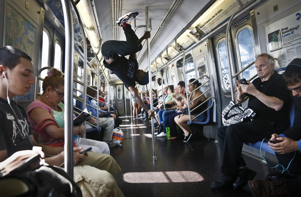 Subway security now pans the antics of Dashawn Martin, center, a member with the dance troupe W.A.F.F.L.E., which stands for We Are Family For Life Entertainment.