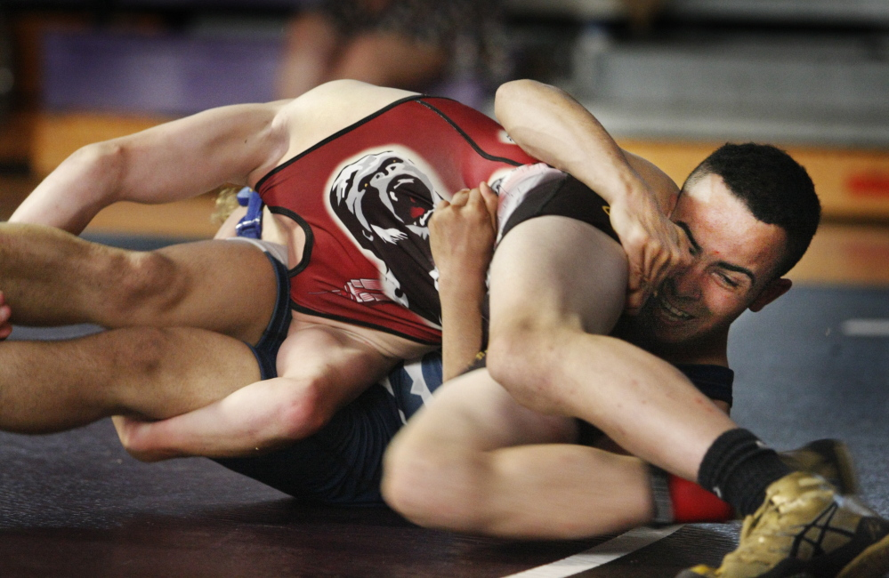 Kidayer Aljubyly of Portland, right, wrestles Phillip Moomey of Nebraska as all-star wrestlers from Maine and Nebraska met in a match at Marshwood High School in South Berwick Tuesday night.