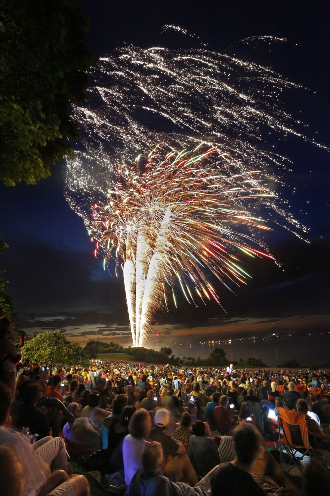Crowds watch the fireworks display during the Stars and Stripes Spectacular 4th of July celebration on July 4, 2013 over the Eastern Promenade in Portland.