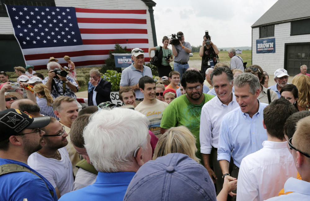 Mitt Romney accompanies New Hampshire senate candidate Scott Brown during a campaign stop at a farm in Stratham, N.H. on Wednesday. Romney endorsed Brown at the event and said he had no interest in making a third run at the presidency.