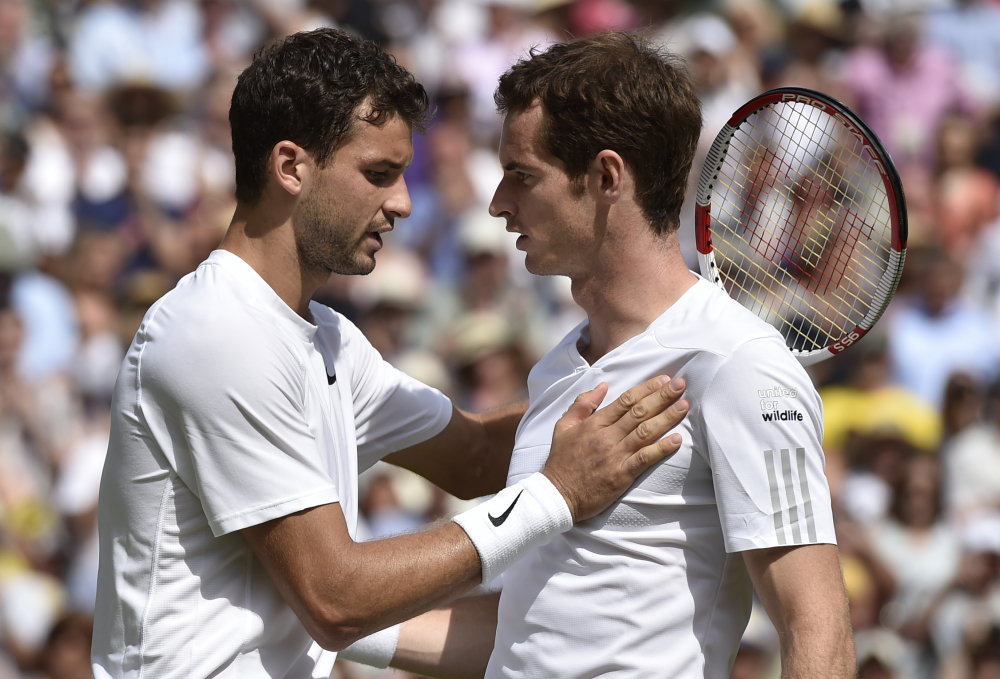 Grigor Dimitrov of Bulgaria, left, is congratulated by defending champion Andy Murray of Britain after winning their men's singles quarterfinal match.