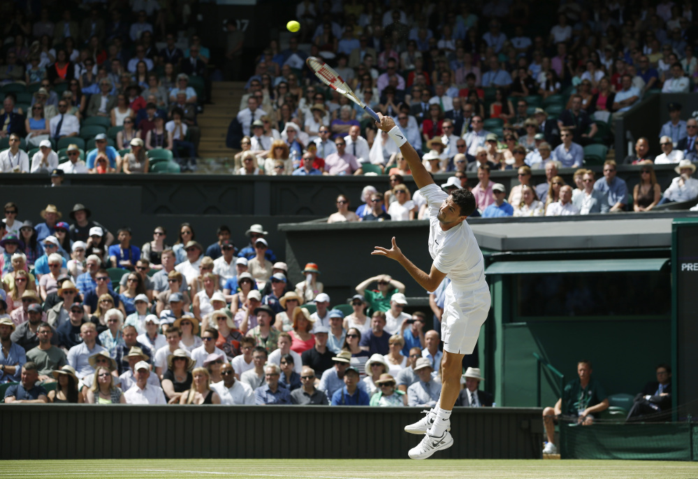 Grigor Dimitrov of Bulgaria serves to Andy Murray of Britain during their men's singles quarterfinal match.
