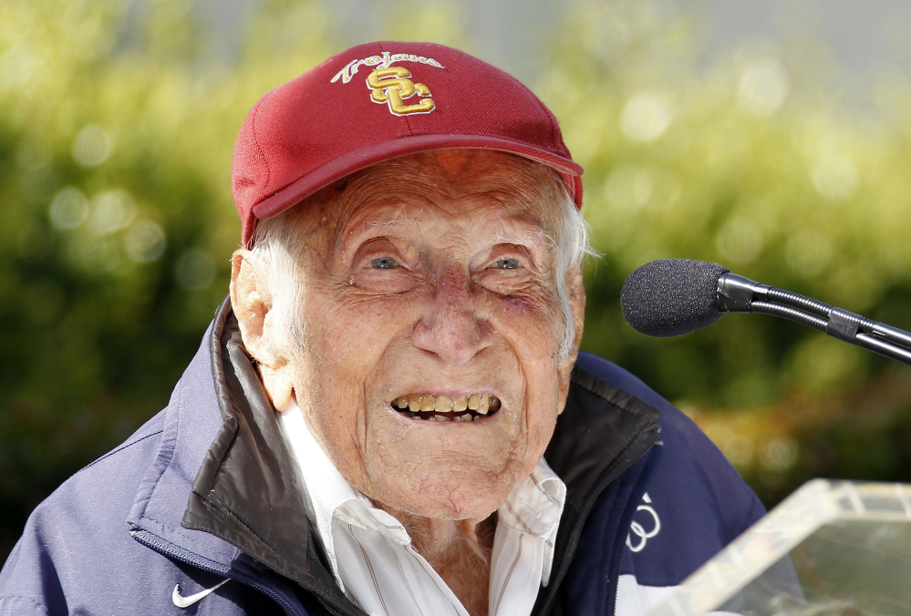 Louis Zamperini appears at a news conference, in Pasadena, Calif., in this May 9, 2014, photo. He died Wednesday at the age of 97.
