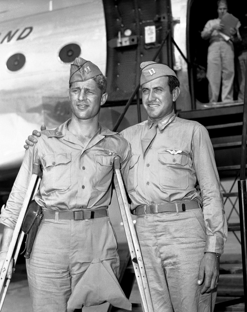 In a Oct. 3, 1945 file photo, Capt. Louis Zamperini (right), Torrence, Calif., former track star, who was adrift 47 days in Pacific after bombing mission against the Japanese and presumed dead, stands with his Pal, Capt. Fred Garrett, Riverside, Calif., upon  their arrival at Hamilton Field, Calif. Both were prisoners of war.