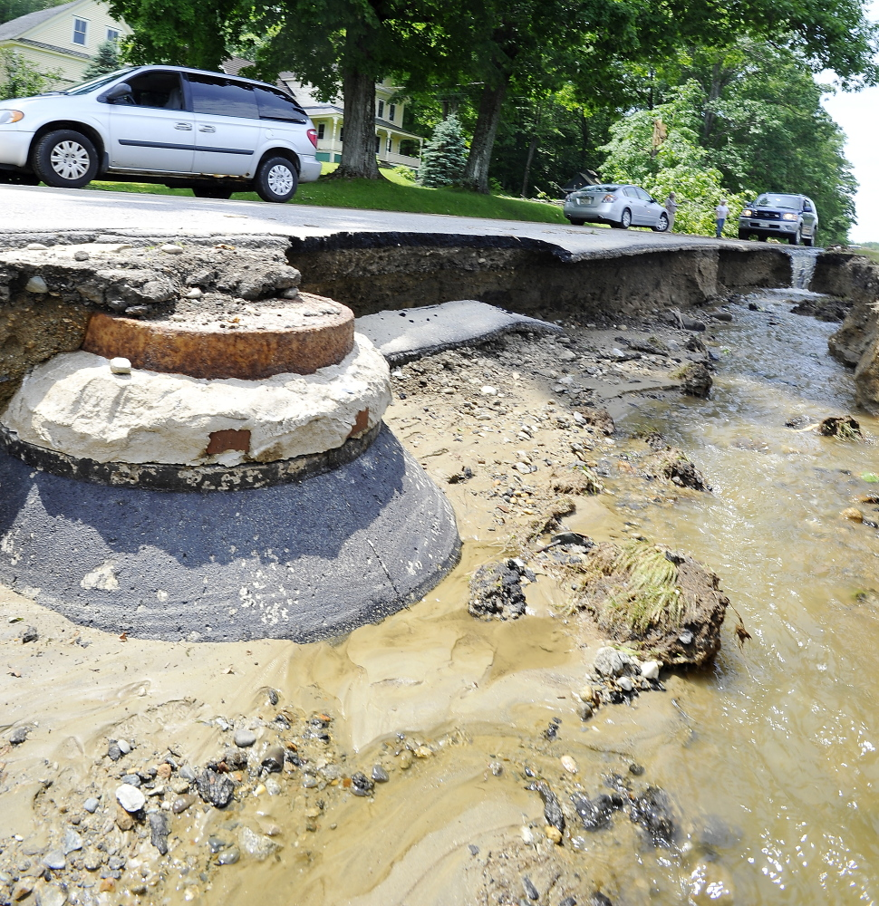 Wyman Hill Road in Rumford is shown on Thursday after being washed out by severe weather on Wednesday.