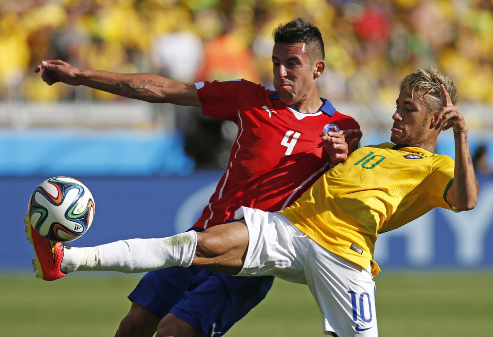 Brazil's Neymar, right, fights for the ball with Chile's Mauricio Isla during their World Cup round of 16 soccer match at Mineirao Stadium in Belo Horizonte, Brazil, on Saturday.