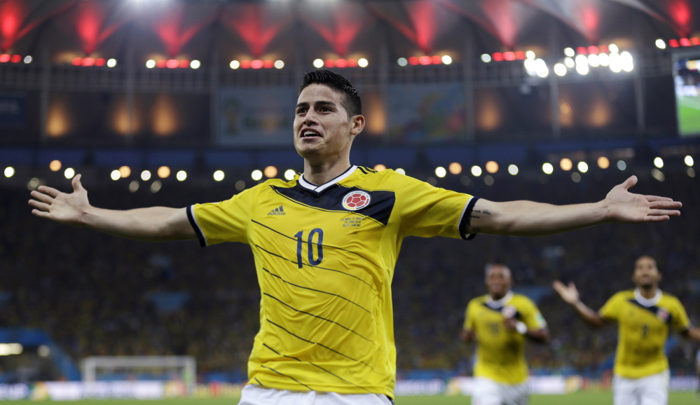 Colombia's James Rodriguez celebrates after scoring the opening goal during the World Cup round of 16 soccer match between Colombia and Uruguay in Rio de Janeiro, Brazil, on Saturday.