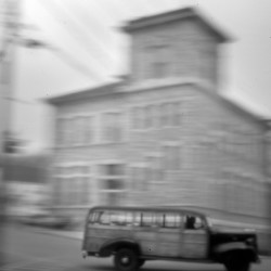 An antique truck steers past the Custom House in Eastport early on April 30. Some leaders and residents of the nation's easternmost city – and elsewhere in Maine – took steps to retaliate against a young attorney when he began to represent the Indians in the mid-1960s.