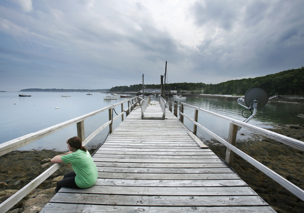After a run, writer Mary Pols rests on a dock in Tenants Harbor that is available with the Yurt she was staying in overnight. Gregory Rec/Staff Photographer