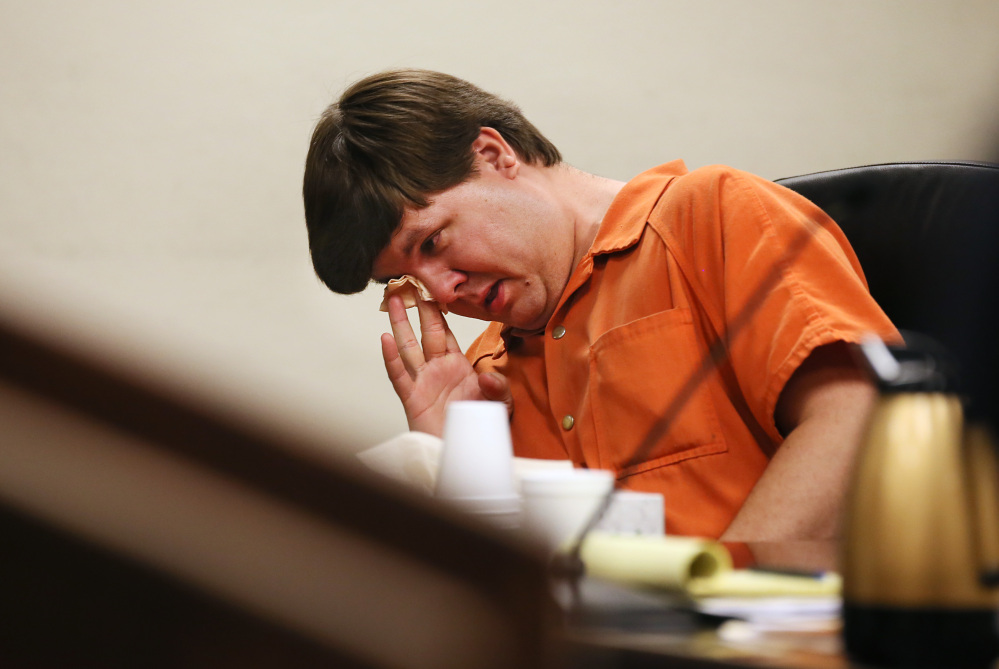 Justin Ross Harris, the father of a toddler who died after police say he was left in a hot car for about seven hours, wipes his eye as he sits during his bond hearing in Cobb County Magistrate Court on Thursday in Marietta, Ga.