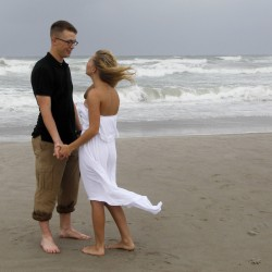 """Newlyweds Seth and Ashley Miller don't let the coming of Hurricane Arthur ruin their big day as they celebrate Thursday at Atlantic Beach, North Carolina, after a small civil ceremony earlier in the day. """"They say rain on your wedding day is good luck,"""" said Seth Miller, a Marine."""