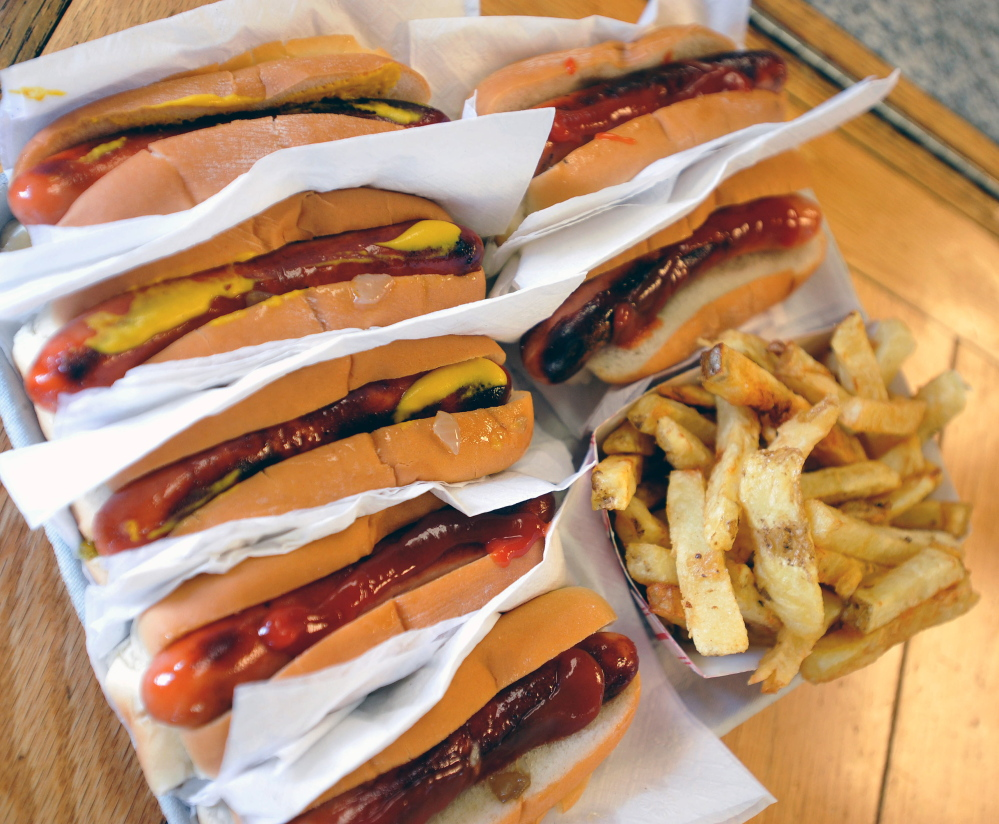 Hot dogs and fries are served at Bolley's Famous Franks on College Avenue in Waterville on Thursday.