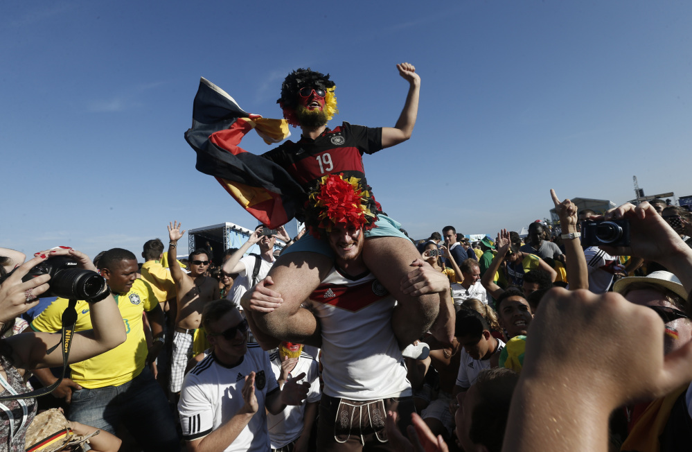 Germany soccer fans celebrate their team's victory inside the FIFA Fan Fest area, where the World Cup quarterfinal match between Germany and France was broadcast live, on Copacabana beach, in Rio de Janeiro.