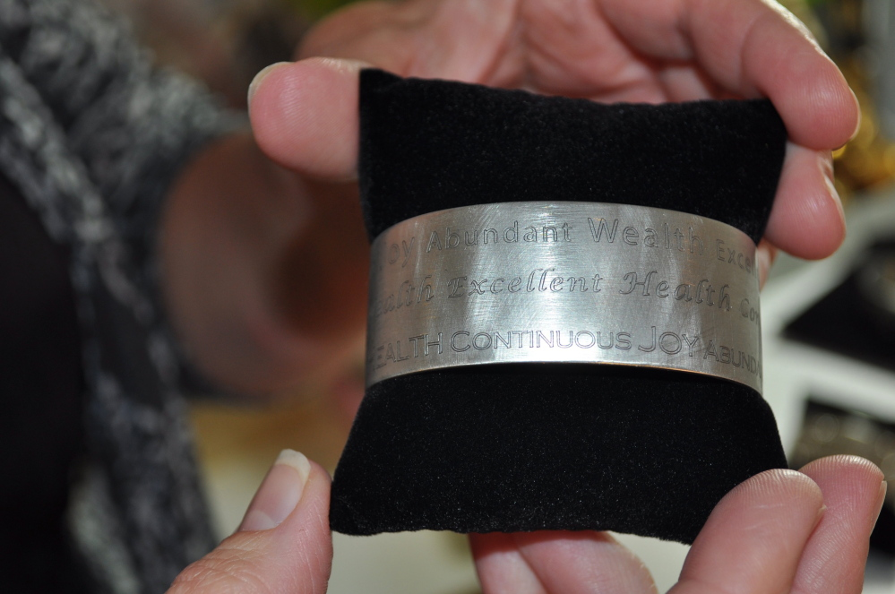 Closing her storefront meant Amanda Carroll could have more time to be creative. Her Sage Words Cuff Bracelet features inspirational messages.