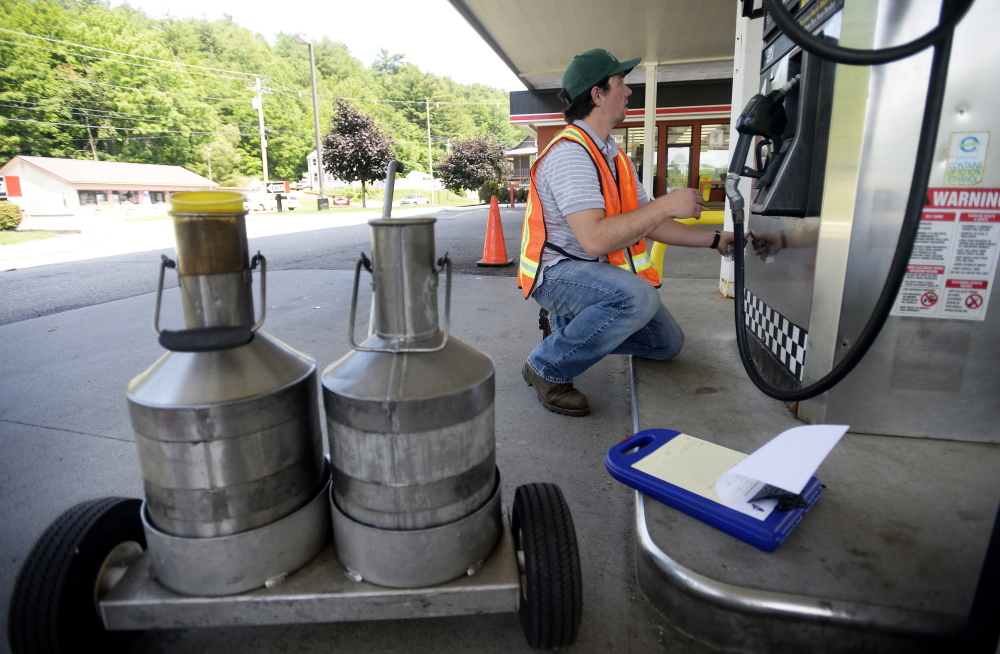 Michael Picard, a consumer protection inspector with the Maine Department of Agriculture, Conservation and Forestry, inspects pumps at J&S Oil Express Stop in Augusta last month.