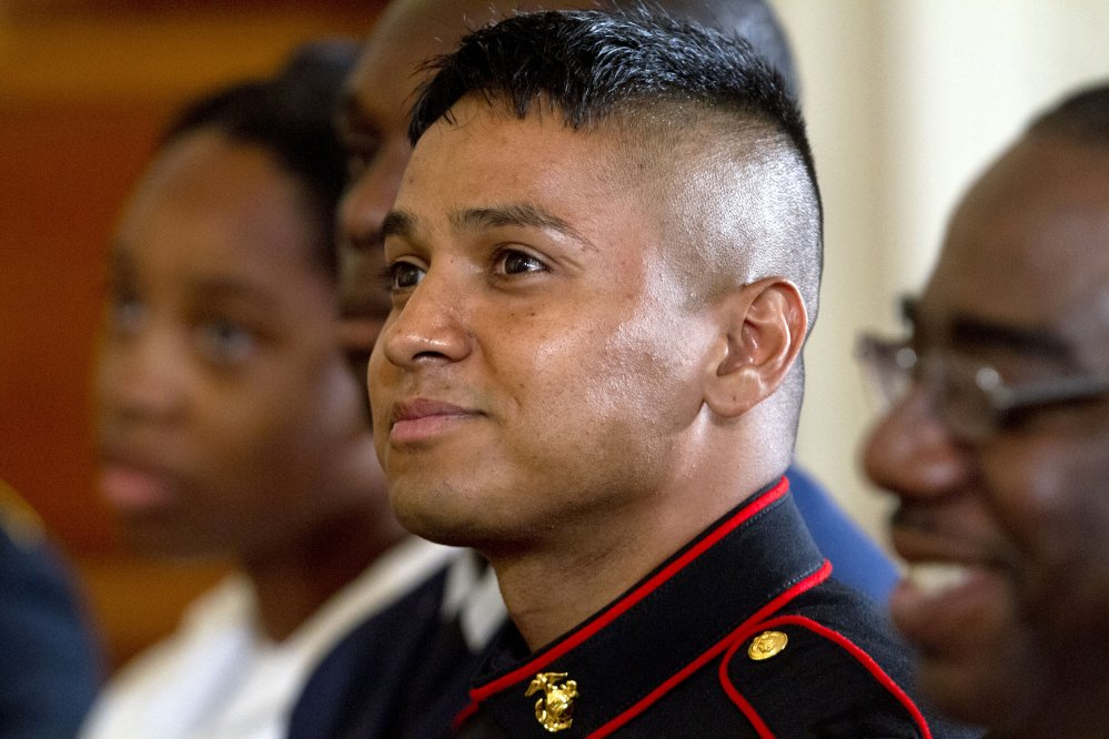 Marine Pfc. Oscar Gonzalez, who was born in Guatemala, listens as President Obama speaks during a naturalization ceremony for active duty service members, including Gonzalez, and civilians on Friday at the White House in Washington.