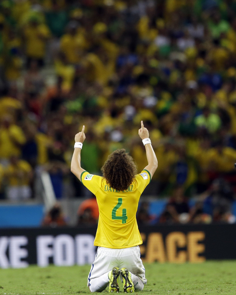 Brazil's David Luiz celebrates after Brazil's 2-1 victory to advance to the semifinals during the World Cup quarterfinal soccer match between Brazil and Colombia at the Arena Castelao in Fortaleza, Brazil, on Friday. Luiz scored his side's second and decisive goal. The Associated Press