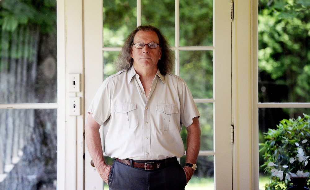 Steve Luttrell, former Portland poet laureate, at his Falmouth home.